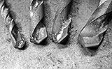 Vier Betonbohrer